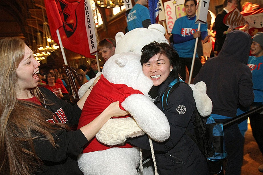 New PhoHo resident Melinda Song '17 gets a hug from a PhoHo bear as Gracie Hurley '14 (left) looks on. Jon Chase/Harvard Staff Photographer