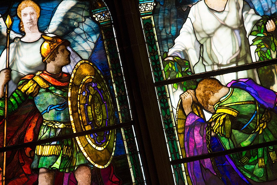 Stained-glass windows made in 1900 by Sarah Wyman Whitman commemorate those who surrendered their lives in the War of the Rebellion inside Annenberg Hall.