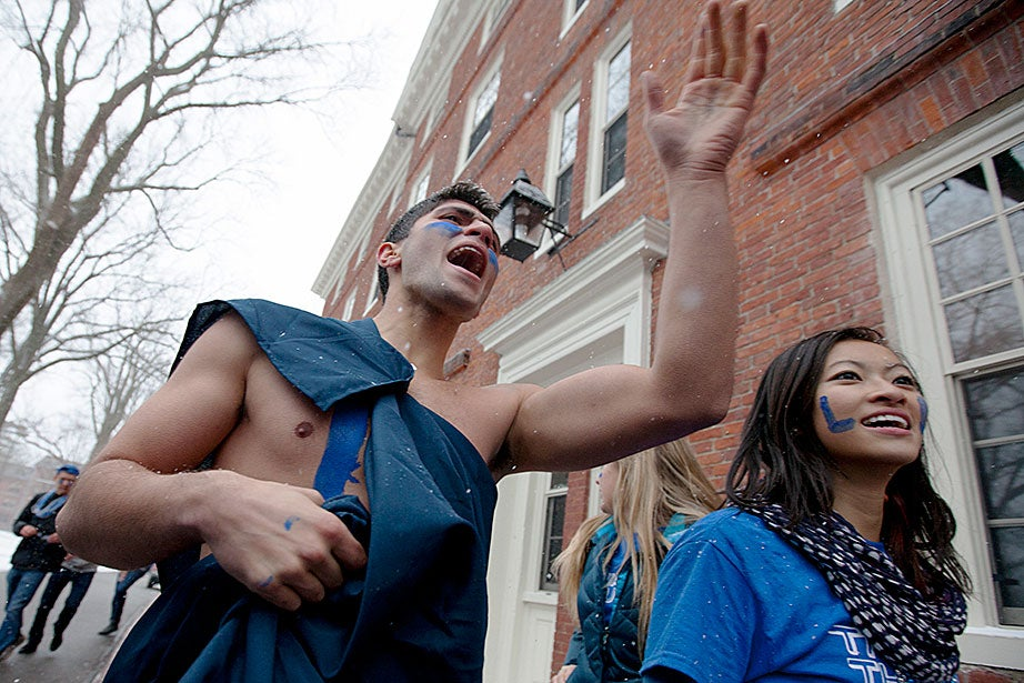 Not even snow can deter these Lowell House students chanting outside Hollis Hall. Rose Lincoln/Harvard Staff Photographer