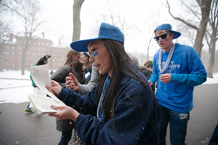 Lowell House students sort through the envelopes that inform freshmen of their assigned House. Rose Lincoln/Harvard Staff Photographer