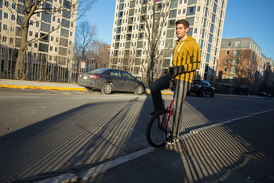 Salvatore Rinchiera '14 learns how to ride a unicycle outside Leverett House.