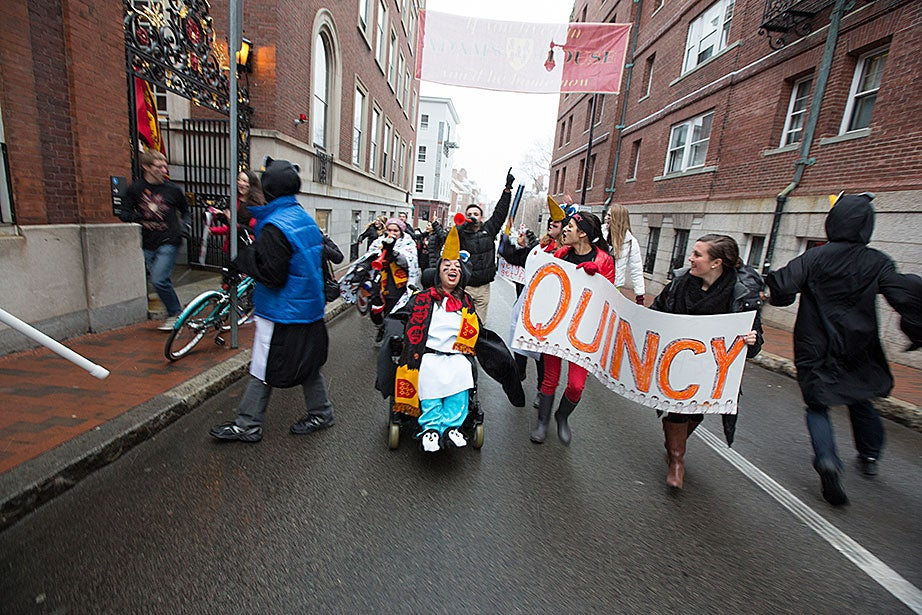 Quincy House residents dash through the Square en route to the Yard. Rose Lincoln/Harvard Staff Photographer