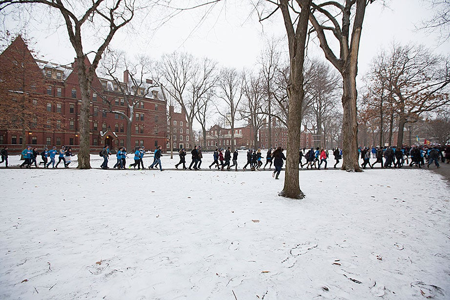 Eliot House residents race across the Yard to the John Harvard statue. Rose Lincoln/Harvard Staff Photographer