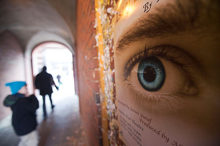 "An advertisement for the student performance of ""Isaac's Eye"" by Lucas Hnath, directed by Jumai Yusuf '16 and produced by Alice Berenson '16, is seen in a tunnel between Massachusetts Avenue and Harvard Yard."