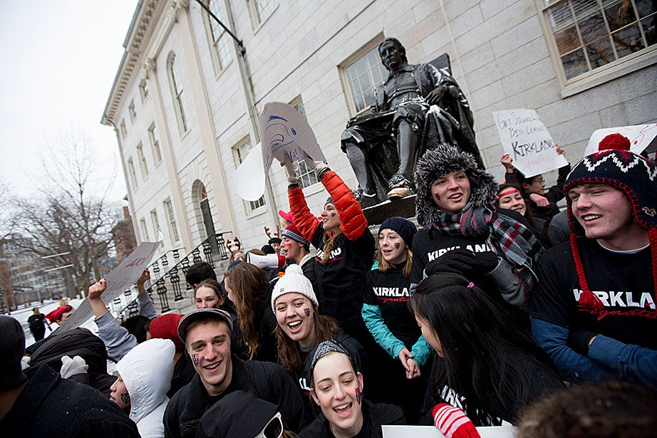 Kirkland House students are the first to arrive in the Yard, snagging the coveted celebration spot in front of the John Harvard statue. Rose Lincoln/Harvard Staff Photographer