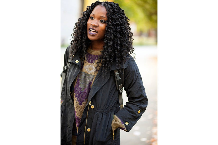 """""""Harvard has better fashion in the fall. This is a men's sweater I got from a thrift store. An oversized cardigan is my fall staple. It can make anything look great,"""" said Lami Olatunji '14. """"I'm wearing eyeliner on my lips and two-tone eye shadow."""""""