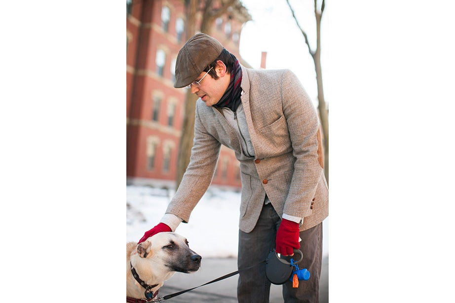 """Matthew Sebastian, part of the A.R.T. stage crew, took his dog Sucuk (Turkish for """"sausage"""") out for a brisk morning walk. """"I like the winter because I can layer. This is one of my favorite tweed jackets, it's vintage."""" But does he like the cold? """"Oh, God no,"""" he guffawed. """"It's freezing."""" He said he keeps warm with whiskey."""
