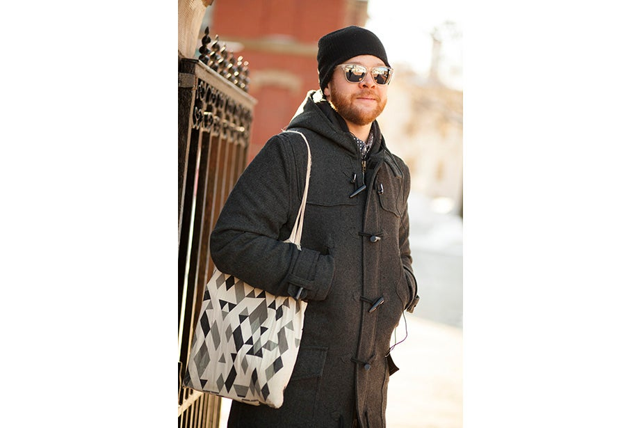 """Joseph Wawrzyn of Somerville was passing through the Yard en route to work. """"I'm nice and toasty, all layered up,"""" said Wawrzyn, who is the singer of Boston band Condor. He prefers winter to summer and said he keeps warm with, """"Layers and snuggles."""""""