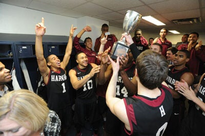 The Harvard men's basketball team celebrated after being presented with the Ivy League trophy. Harvard beat Yale, 70-58.