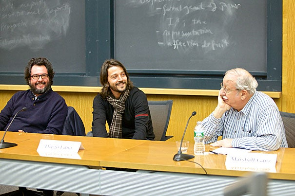 """After a screening of their new film """"Cesar Chavez,"""" director Diego Luna (center) and producer Pablo Cruz (left) spoke with Marshall Ganz, a senior lecturer in public policy at the Harvard Kennedy School who worked with Chavez in the 1960s. """"Nothing has been so personal in my life,"""" said Luna about telling Chavez's story."""