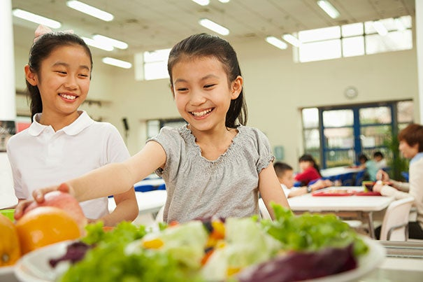 A Harvard study contradicts criticisms that the new federal standards requiring schools to offer healthier meals have led to increased food waste. Instead, the study finds it's led to an increase in fruit and vegetable consumption.