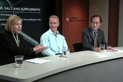 """Many consumers have no idea how much sugar and salt is in their food,"" said Professor JoAnn Manson (from left), who believes the new food labels will pressure food manufacturers to address the issue. Joining Manson for the HSPH forum discussion ""Sugar, Salt, and Supplements: Sorting the Science""  were Associate Professor Dariush Mozaffarian and Professor Frank Hu."