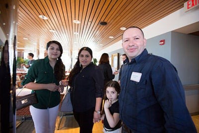 """I've been waiting on this moment for a long time and finally it's here,"" said Israel Argueta (photo 1), who was joined by his partner, Sulma Garcia, and daughters Kimberly, 12, and Kelsey, 5, at the Bridge Program's annual dinner. Margarita Pleitez (left, photo 2) and her mentor, Mariana Gudino, talk with President Drew Faust. Juan Carlos Martinez Roa (right, photo 3) is congratulated by mentor Colin Diersing '16."