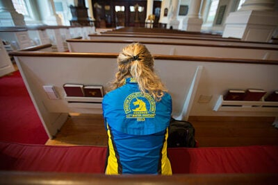 Madeline Cooper '16 (photo 1) said she will run the Boston Marathon again this year. Cooper and Patrick Rooney '14 (photo 2), who ran the marathon last year, were at the Memorial Church for a quiet moment of remembrance. Harvard landscaper Danny Mata (photo 3) prepared the church for the day's events by placing daffodils on its steps.