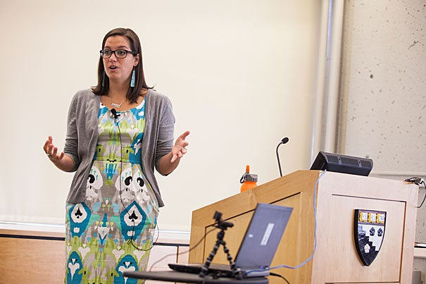 Adrienne Keene (photo 1) presented her dissertation in front of a public audience as part of the Harvard Graduate School of Education's annual dissertation and capstone defenses program. Professor Sara Lawrence-Lightfoot (photo 2) listened and made notations during Keene's 90-minute defense.