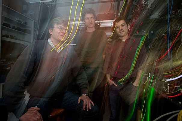 "Professor of Physics Mikhail Lukin (from left) led a team consisting of postdoctoral fellow Tobias Tiecke and graduate student Jeff Thompson that has created quantum switches that could one day be networked via fiber-optic cables to form the backbone of a ""quantum Internet"" that allows for perfectly secure communications, said Lukin."