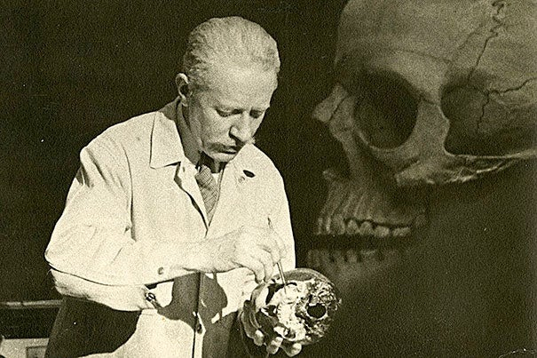 "Surgeon and anatomist Robert M. Green (photo 1) lectures at Harvard Medical School in 1941, standing in front of a large-scale wood pulp model of the skull made in the 1890s. Illustrations (photo 2) from Juan Valverde de Amusco's ""Anatomia del corpo humano"" (1560).  A 1610 engraving of the anatomical theater of Leiden University (photo 3)."