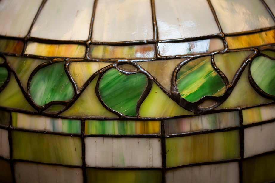 An unsigned Louis Comfort Tiffany lamp is part of the room's original décor.