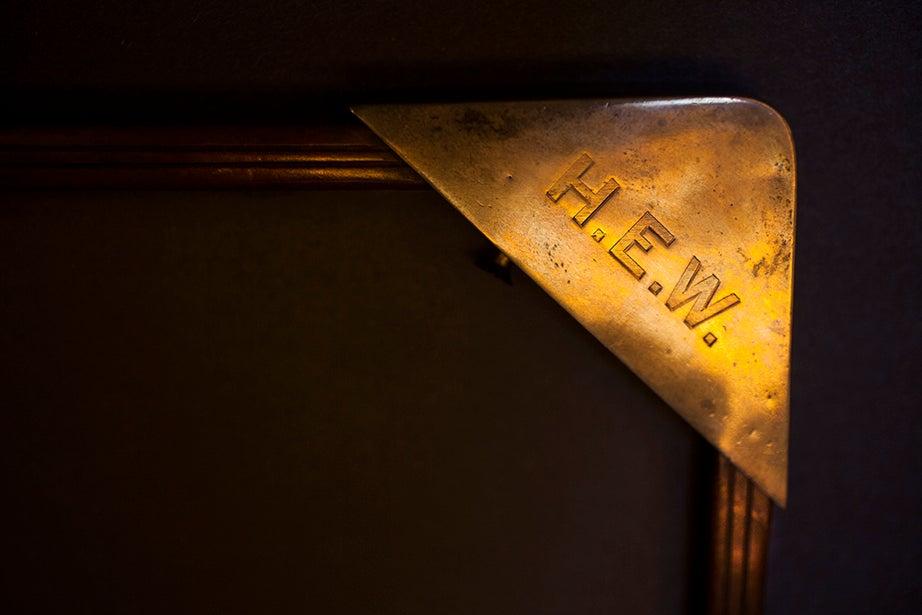 A monogramed tray belonging to Harry Elkins Widener sits atop his desk.
