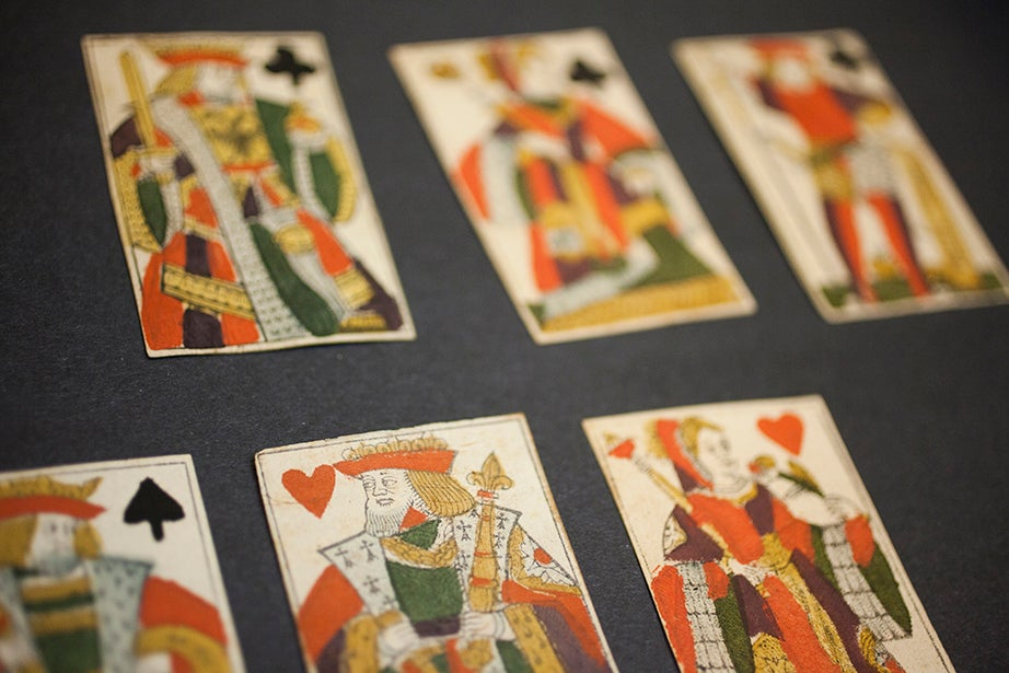The collection includes a series of woodcut, hand-colored playing cards, circa 1750.