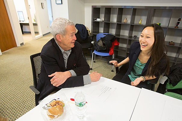 New to social media, Tom Kelly (left, photo 1) still found common ground with Michelle Luo '14, who has been a teaching fellow for CS50 and an intern at Google. Judith Singer (from left, photo 2), senior vice provost for faculty development and diversity, remembered signing up for Facebook in its early Harvard-only days. Director of the Harvard Global Health Institute Sue Goldie said she uses Twitter in a  targeted manner, to make sure her kids are not in any trouble.