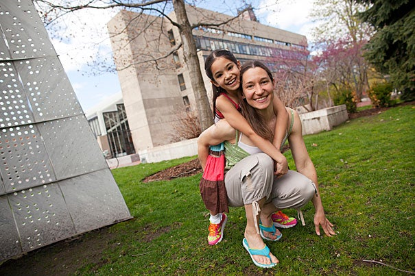 Natalia Gaerlan, pictured here with 9-year-old daughter Malaya, is a landscape architect who became intrigued by coastal cities in developing countries that will be hardest hit by the consequences of climate change. She arrived at Harvard in the fall of 2012, and three dramatic events marked her first year: Hurricane Sandy, winter storm Nemo, and the Boston Marathon bombings.
