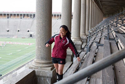 """Rugby has """"been a huge part of what I've done here, and a lot of the people I'm closest to at Harvard are my teammates,"""" said Shelby Lin '14, who in the fall will head to Pembroke College at the University of Cambridge in England to study public health on a Harvard-Cambridge Scholarship."""