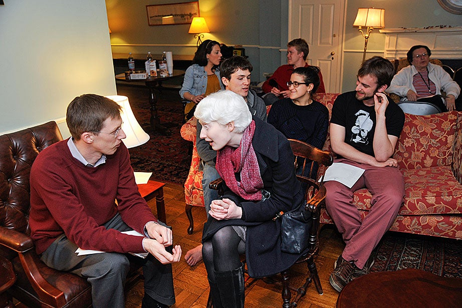 Resident Scholar Sandy Alexander (left) talks to Marina Connelly from the Graduate School of Arts and Sciences before the poetry reading. Alexander read a poem by John Updike, while Connelly read three of her own poems.