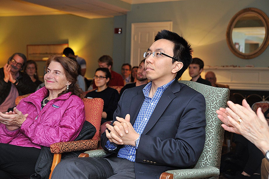 Van Tran, a former Lowell House tutor who now teaches at Columbia University, returned to Cambridge for the evening. Kitty Pechet (left), whose husband was the late Maurice Pechet, a longtime member of the Lowell House Senior Common Room, is an artist and regular attender at Lowell events.