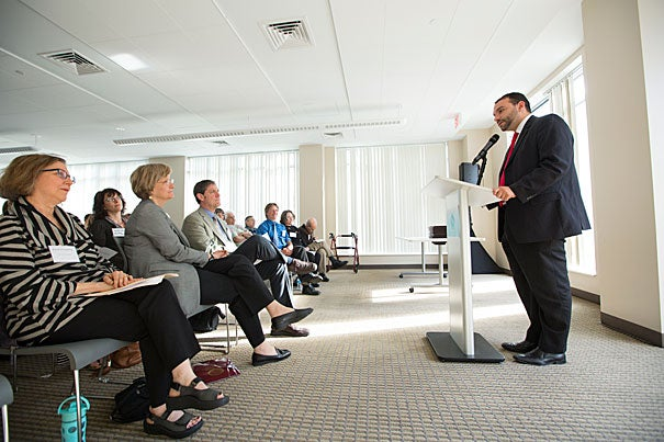 Felix Arroyo (above), chief of Boston's Health and Human Services Department, and State Rep. Kevin Honan were on hand to present the Harvard Allston Partnership Fund grants, which totaled $100,000.