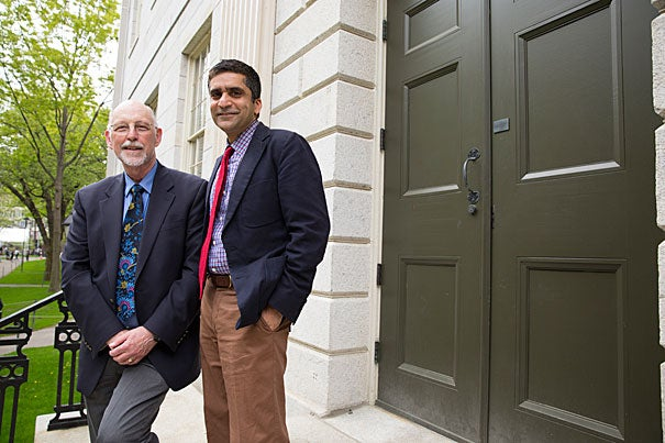 "Both Donald Pfister (left) and Rakesh Khurana believe strongly that an important role for the dean is to foster and build the College community of learning. ""My goals were modest in a way, but they were really about reaching out and connecting with the students, and working within the College to make sure we weren't merely in a transition, but moving the College forward,"" said Pfister, who now turns the reins over to Khurana."