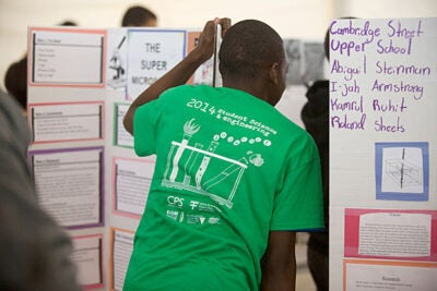 "Local students showcased their final science and engineering projects at Harvard (photo 1) to viewers including Cambridge Public Schools Superintendent Jeffrey Young (from left, photo 2) and Cambridge Mayor David Maher. ""We have one of the most enlightened cities in the country for the sciences, engineering, the arts, and culture,"" said Kevin Casey, acting vice president for Harvard Public Affairs and Communications (photo 3). ""This city understands that the only way for all of those to come together and make progress is when all of those fields work together."""