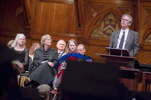 """For the 224th Phi Beta Kappa Literary Exercises, President Drew Faust (center) hosted novelist and short story writer Andrea Barrett (left) and poet, translator, and critic Donald Revell (at podium), who read from his collection """"Pennyweight Windows."""""""