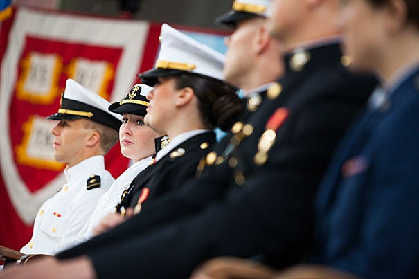 """""""You will honor the service and sacrifice of those who came before you through your own commitment,"""" said President Drew Faust (photo 2) in her remarks at the ROTC Commissioning Ceremony, where seven soon-to-be Harvard graduates, including Taylor Evans (photo 3), received their first military assignments."""