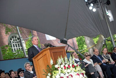 Delivering Harvard's Commencement address, former New York City Mayor Michael Bloomberg (photo 1) called on the Class of 2014 to safeguard free speech and inquiry. President Drew Faust (right, photo 2) recognized outgoing HAA Executive Director Jack Reardon with a special Harvard Medal.