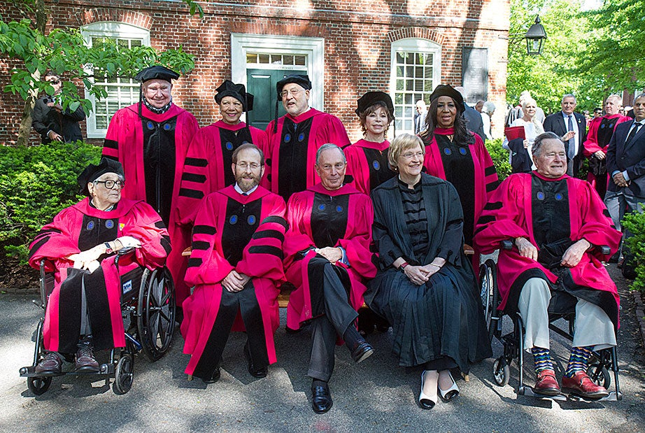 President Drew Faust (center, in black) and Harvard Provost Alan Garber (front row, second from left) pose with this year's honorary degree recipients: (front row, from left) Seymour Slive, Michael Bloomberg, former President George H.W. Bush, Peter Raven (back row, left to right), Patricia King, Joseph E. Stiglitz, Isabel Allende, and Aretha Franklin. Jon Chase/Harvard Staff Photographer