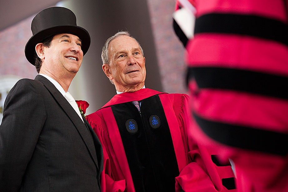 Harvard Corporation member James Breyer (left) and Commencement speaker Michael Bloomberg onstage. Stephanie Mitchell/Harvard Staff Photographer