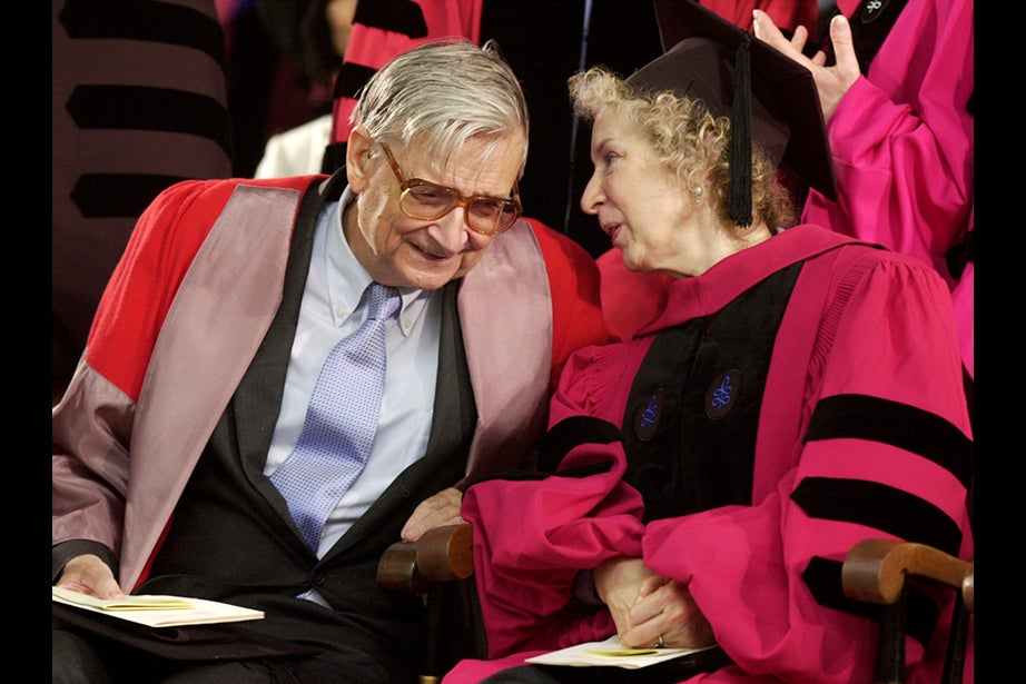 """E.O. Wilson, the American biologist famous for his study of ants, and author Margaret Atwood, the celebrated Canadian writer of """"The Handmaid's Tale,"""" confer during the Morning Exercises in 2004. Jon Chase/Harvard Staff Photographer"""