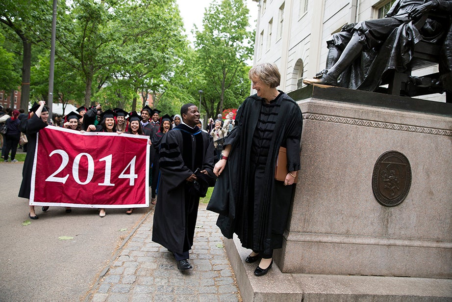 Pusey Minister in the Memorial Church Jonathan Walton and Harvard President Drew Faust lead the procession to the Baccalaureate Service for the Class of 2014. Stephanie Mitchell/Harvard Staff Photographer