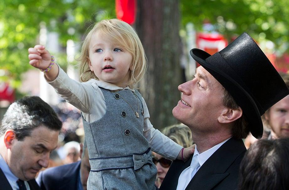 Hazel Harmon, 2, looks on in wonder with her father, James Harmon '93. Jon Chase/Harvard Staff Photographer