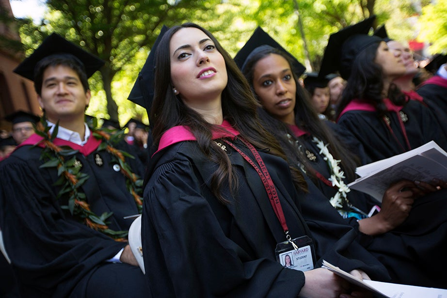 Harvard Business School graduates Malike Abacioglu (from left), Marisa Clark, and Diva Ramola enjoy Commencement exercises. Kris Snibbe/Harvard Staff Photographer