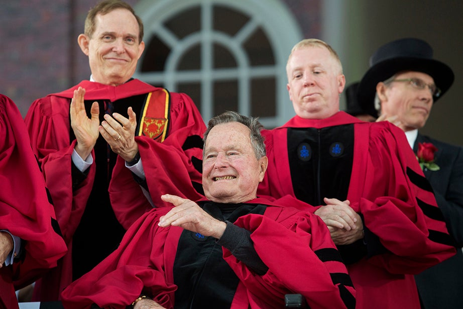 Former President George H.W. Bush acknowledges applause after receiving his honorary degree. Jon Chase/Harvard Staff Photographer