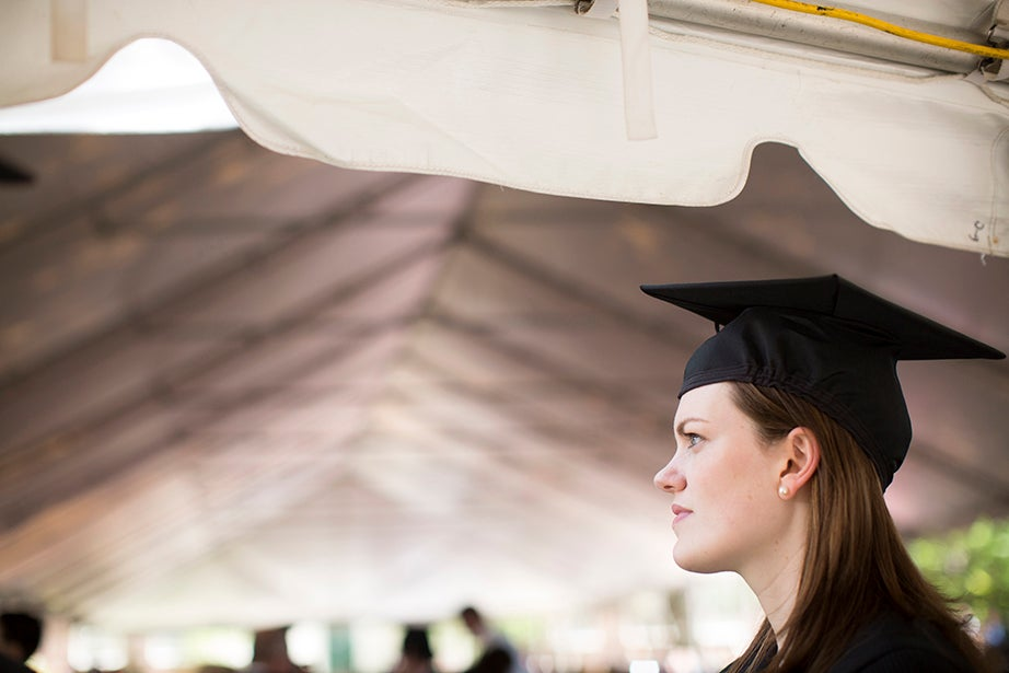 Elizabeth Mary Parker attends Commencement activities outside of Winthrop House. Stephanie Mitchell/Harvard Staff Photographer