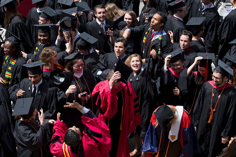 Incoming Harvard College Dean Rakesh Khurana tosses his cap at a Cabot house diploma ceremony. Rose Lincoln/Harvard Staff Photographer