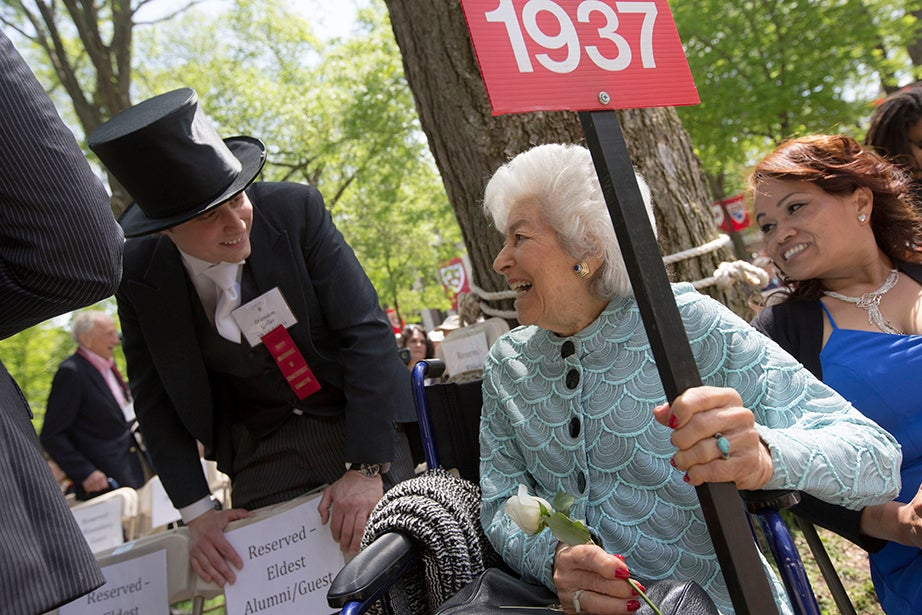 During the Annual Meeting of the Harvard Alumni Association, the oldest alumna in attendance, Lillian Sugarman '37, heads the row and shares a laugh with Happy Committee member Brandon Geller. Kris Snibbe/Harvard Staff Photographer