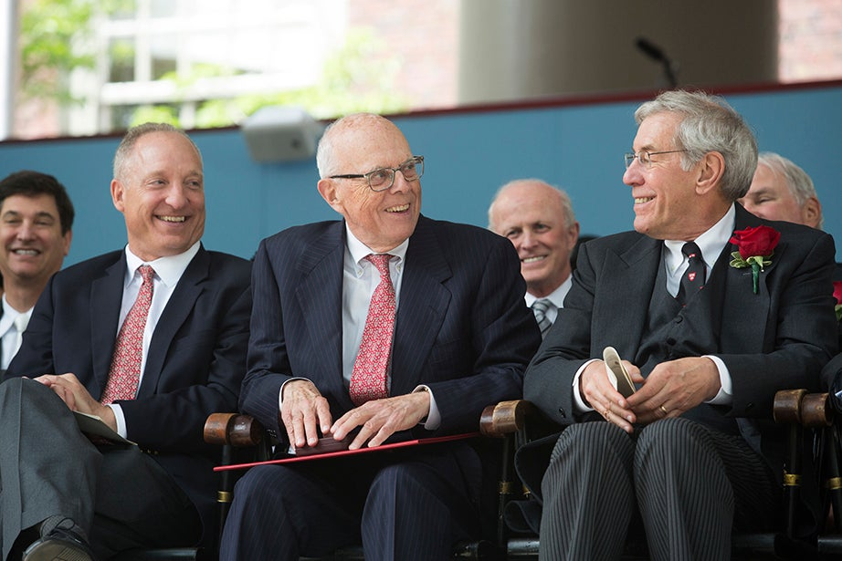 Jack Reardon (center) is applauded after receiving a special award as Faculty of Arts and Sciences Dean Michael D. Smith (left) and Harvard Corporation senior fellow Robert D. Reischauer (right) look on. Jon Chase/Harvard Staff Photographer