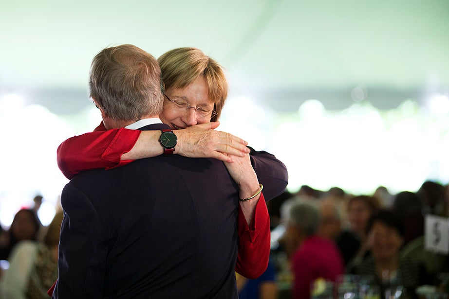 President Drew Faust embraces former Harvard president Neil Rudenstine after she received the 2014 Radcliffe Medal. Rudenstine recruited Faust to Harvard, and Faust was the founding dean of the Radcliffe Institute for Advanced Studies. Stephanie Mitchell/Harvard Staff Photographer
