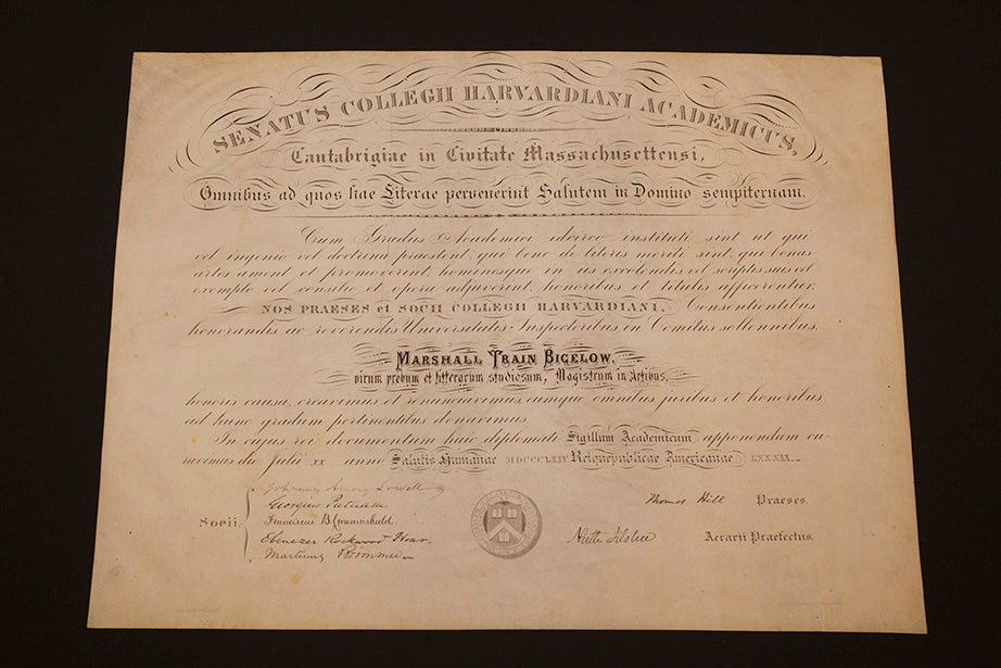 An 1864 honorary Master of Arts degree diploma for Marshall Train Bigelow, signed by Harvard President Thomas Hill. This represents an era — 1860 to 1902 — characterized by extra-large Harvard diplomas.