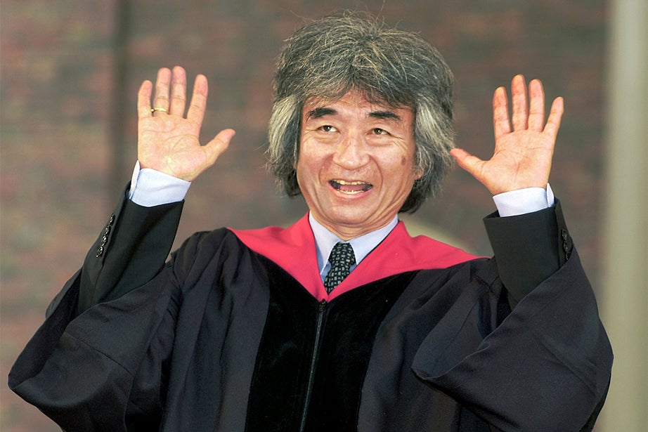 Seiji Ozawa, conductor of the Boston Symphony Orchestra (BSO), gestures after receiving his honorary degree at Commencement in 2000. His tenure at the BSO lasted for 29 years, the longest of any music director in its history. Jon Chase/Harvard Staff Photographer