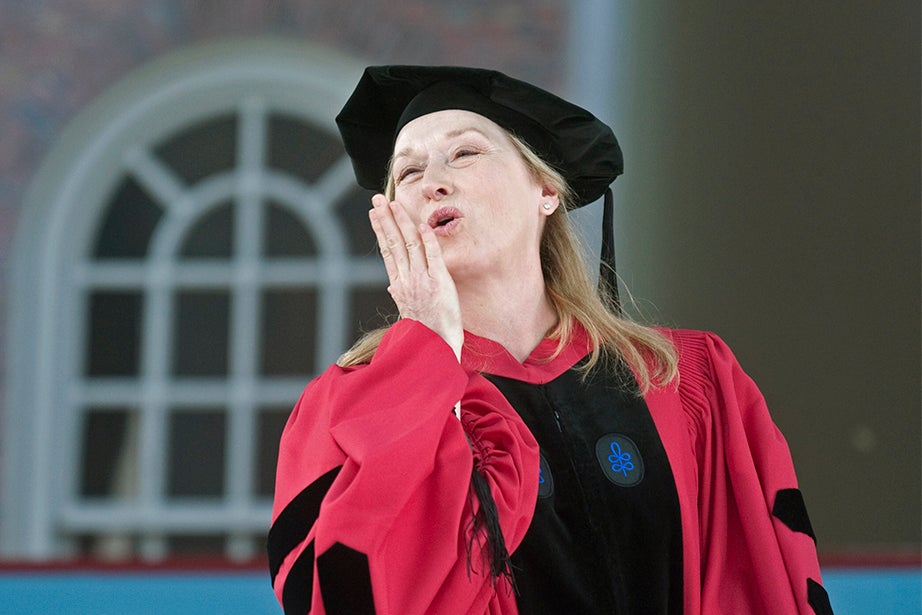"""Actress Meryl Streep blows a kiss after receiving her honorary degree in 2010. Streep won the Academy Award for best actress for her roles in """"Sophie's Choice"""" (1982) and later for """"The Iron Lady"""" (2011). With 18 Academy Award nominations in 35 years, Streep holds the record for most nominated actor, male or female, in film history. Jon Chase/Harvard Staff Photographer"""